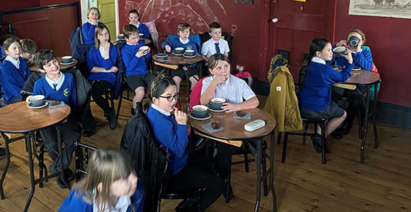 Children from Hawkshead Esthwaite Primary School enjoying their hot chocolate and film.