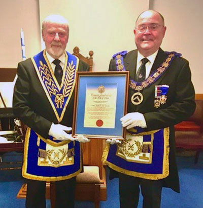Bill (left) receiving his certificate from Roger Southern DProvGM.