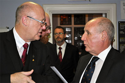 Gary Rogerson (left) discussing the boxing event with chairman Barrie Bray.