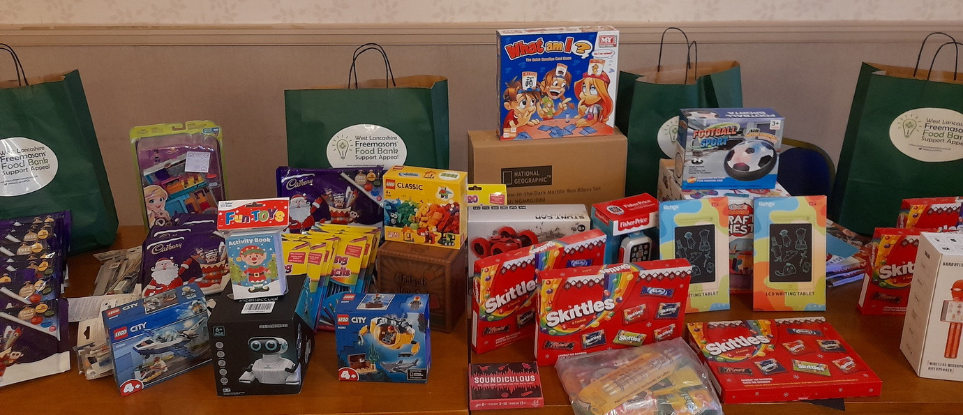 A selection of toys and chocolates for the children