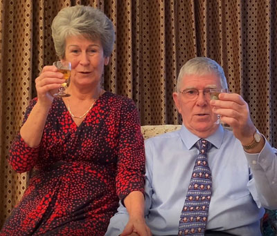 Tony and Maureen give a toast to your health.