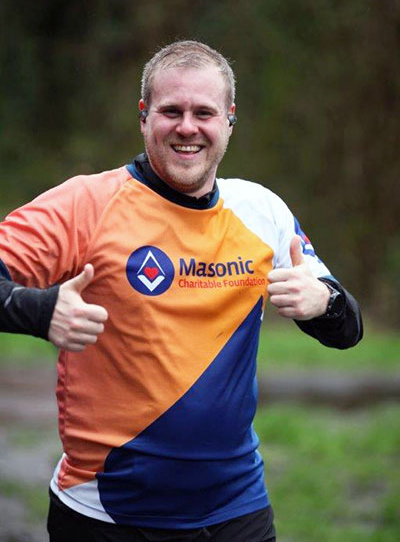 Adam Eeles proudly training for the marathon in his MCF t-shirt.