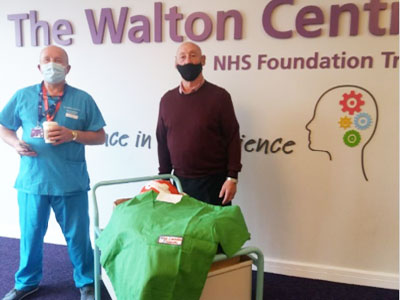 Taking delivery. Professor Paul May (left), Consultant Neurosurgeon and Jim Corcoran.