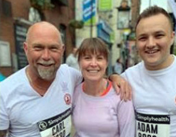 Carl Daggers (eft) with Adam Dennett (right) and a fellow runner at the Manchester 10K.