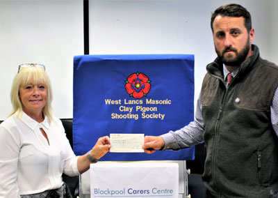 Terri Hodkinson (left) receives the cheque for £500 from David Jenkinson