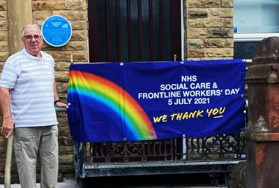 Colin Goodwin proudly displays the banner of support for the NHS, Social Care and Frontline Workers' Day.