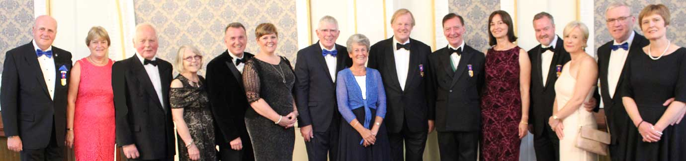 Pictured from left to right, are: David and Sue Winder, Howard and Sue Wilson, Paul and Claire Crockett, Tony and Maureen Harrison, Sir David Wootton, Richard and Diana Hone, Les and Debbie Hutchinson and Philip and Lynn Preston.