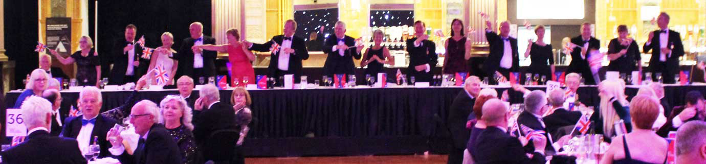 The principal guests on the top table rocking along to the sounds of the Magnificent Singing Waiters.